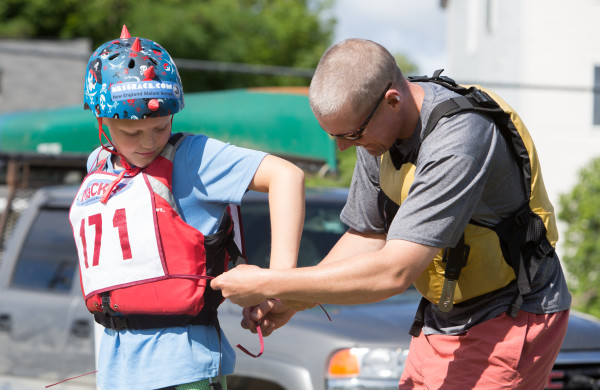 On Thursday morning, JR Mabee ties his son's racing bib. The father-son duo were a team in the morning race.