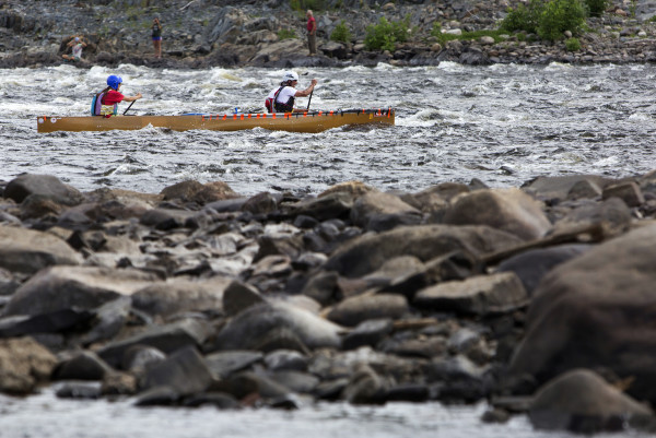 Lori Dana and Barry Dana make their way down river during the Penobscot River Whitewater Nationals Regatta that started in Old Town and ended in Eddington on Thursday. Races will happen throughout the weekend.