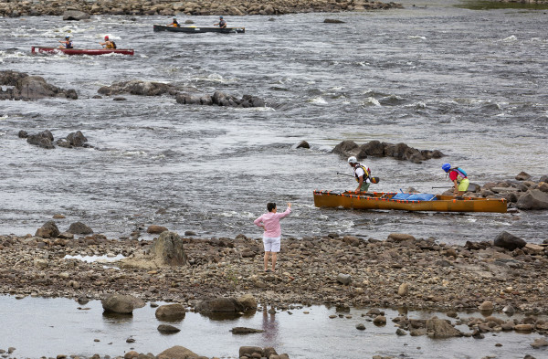 Racers make their way down river during the Penobscot River Whitewater Nationals Regatta that started in Old Town and ended in Eddington on Thursday. Races will happen throughout the weekend.