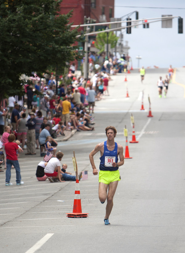 Adam Goode leads the pack during the 34th annual Walter Hunt Memorial Fourth of July 3K road race July 4, 2014.