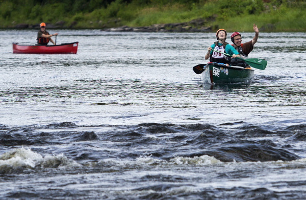 Molly Picone (second from right), 17, and John Picone (right) celebrate after finishing the Penobscot River Whitewater Nationals Regatta that started in Old Town and ended in Eddington on Thursday. Races will happen throughout the weekend.