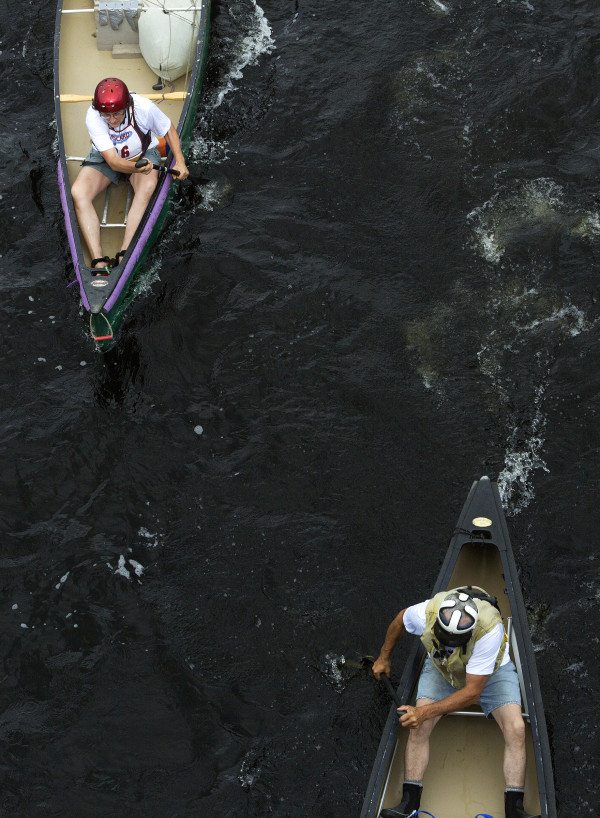Racers take off during the Penobscot River Whitewater Nationals Regatta that started in Old Town and ended in Eddington on Thursday. Races will happen throughout the weekend.