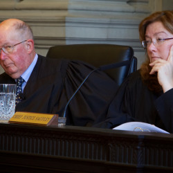 Chief Justice Leigh Saufley (right) and Justice Donald Alexander of the Maine Supreme Judicial Court are seen in this September 2013 file photo.