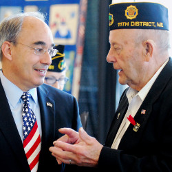 U.S. Rep. Bruce Poliquin (left) talks with legion member Ronald Cropley at the American Legion Conference at the Cross Insurance Center in Bangor June 20, 2015.