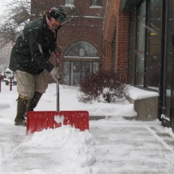 Zoo Cairn shovels snow outside Fidelity Investments, near Middle Street in Portland, on Friday, Feb. 8, 2013, during the early part of a storm that would bring a record 31.9 inches of snow to the city.