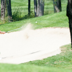 John Hayes IV chips out of a bunker on the 13th hole during the first round of the Maine Amateur golf championship on Tuesday at Waterville Country Club in Oakland.