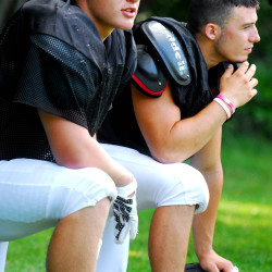 Davis Turner (left), linebacker for Oxford Hills, and Matt Ring, defensive end for Windham High School, take a break from practice at the Lobster Bowl Media Day July 14 at Foxcroft Academy in Dover-Foxcroft.