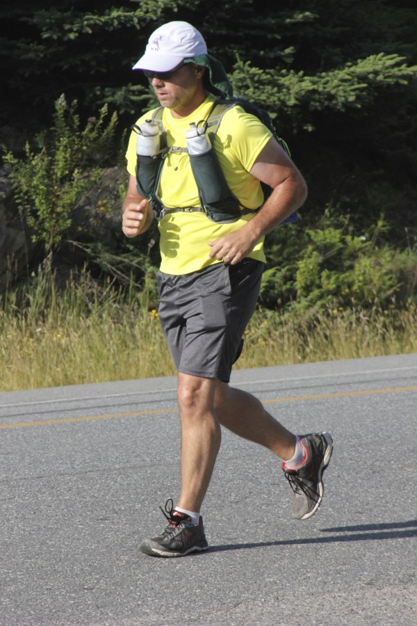 Stephen Moyer runs along Route 1 in Steuben Thursday at about 5:30 p.m. on his way from St. Stephen, Canada, to Key West, Florida.