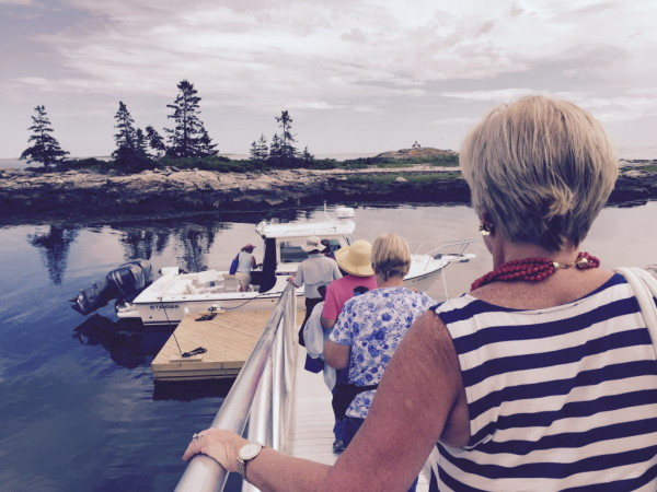 Guests leave Southport by boat for a weekend stay at The Inn at Cuckolds Lighthouse.