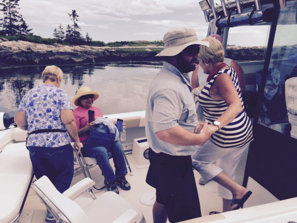 Guests leave Southport by boat for a weekend stay at The Inn at Cuckolds Lighthouse for the weekend.