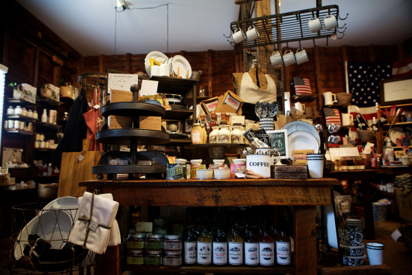 Farm + Table, purveyors of small-batch household and gift items, sits housed in a big red barn in Cape Porpoise. Liz and Bruce Andrews opened the shop this spring in the late 19th century building that used to shelter a livery stable.