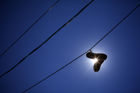 A pair of sneakers hang from a power line on Boynton Street in Portland on Thursday, Aug. 13.