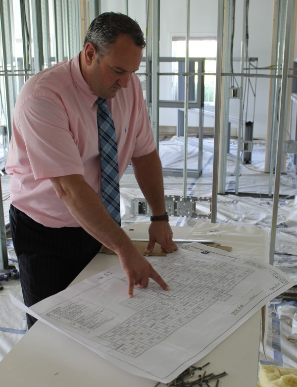 County Federal Credit Union CEO and President Ryan Ellsworth reviews blueprints at the construction site in Presque Isle where contractors are busy making alterations to an existing building that will be repurposed as administrative offices and space for support services and document storage.