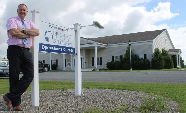 County Federal Credit Union CEO and President Ryan Ellsworth stands at the entrance to the future home of his company on Carmichael Street in Presque Isle. CFCU has purchased the former Maine Public Service operations center and is repurposing the facility to serve as the financial institution's administrative headquarters and processing center.