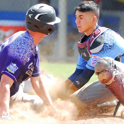 U.S. Southwest of Texas player Joe Gobillot (left) is tagged out by U.S. West catcher German Rodriguez during the opening game of the Senior League World Series Sunday at Mansfield Stadium in Bangor.