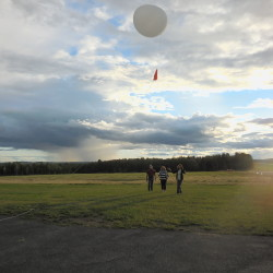 Brenda Felch and Sharon Ouellette of the Caribou branch of the American Association of University Women release the 7 p.m. weather balloon at the National Weather Service office in Caribou Aug. 6, with guidance from Pete Rahe, observational program leader for the office.