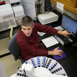 Chemist Jamie Foss demonstrates mass spectral analysis instruments at the state drug testing lab in Augusta recently.