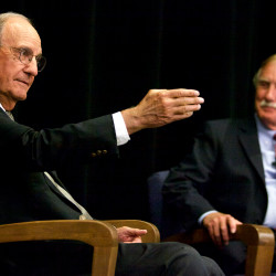 Sen. Angus King of Maine (right) listens to former Maine Sen. George Mitchell at a forum discussing the proposed nuclear deal with Iran at the University of Southern Maine in Portland on Wednesday.