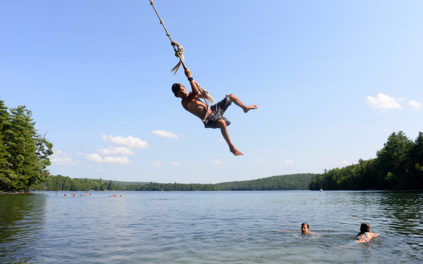Jeremiah Vadas, 11, of Orrington flies high on a rope swing while beating the heat at Craig Pond in Orland on Monday afternoon.  Local lakes were the place to be for many on Monday as the temperature approached 90 degrees.