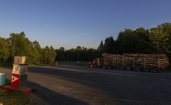 A logging truck sits in the parking lot of Comstock Camps after a day of logging Tuesday.