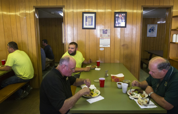 Comstock logging  workers enjoy a home cooked meal after a long day of work in the fields Tuesday. Meanie Morrell is one of the last remaining cooks at logging camps. Morrell not only provides dinner for around 20 workers, she also makes sure to clean up the sleeping areas.
