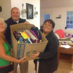 Holly Lundquist of Brewer (left), Brewer Mayor Matthew Vachon and his mother Michele Butera, hold a box filled with school supplies donated to Back to School with the Proper Tools, an effort Lundquist launched July 25 to provide backpacks filled with school supplies to donate to children in need.