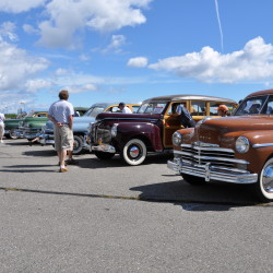 Auto enthusiasts and prospective bidders peruse auction vehicles on display at the OHTM during the 2014 Auto Auction Preview Week. The Owls Head Transportation Museum will host a preview week in advance of their 2015 New England Auto Auction™ beginning Monday, August 17 and extending through Friday, August 17. The New England Auto Auction will commence at 9:30 a.m. on Saturday, August 22.
