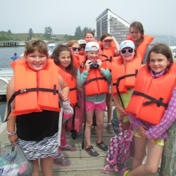 Summer campers get off the boat at Allen Island