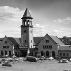 Union Station on Washington Street dominated downtown after opening in 1907 until its demolition in 1961. The brick structure served Maine Central Railroad passengers, as well as the Bangor and Aroostook Railroad. Its grand illuminated bell tower clock was visible for many miles. This photo was taken in August 1960.