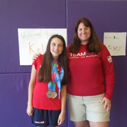 Kelsey Tripp, 18, of Winterport, is pictured with her hometown coach, Andrea Lee. Tripp won gold in the 50-meter freestyle swim at the Special Olympics July 28.