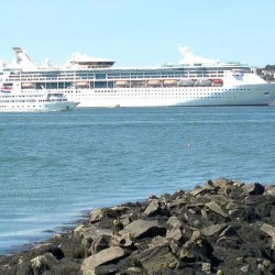 The small and large of Portland's cruise ship industry: the 98-passenger Independence heads out to sea Saturday, Sept. 5, while the 2,000-passenger Grandeur of the Seas is docked at the Ocean Gateway terminal.