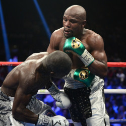 Floyd Mayweather (right) and Andre Berto box during their WBA/WBC welterweight title bout Saturday night at MGM Grand Garden Arena in Las Vegas. Mayweather won via unanimous decision.