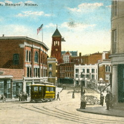 Much of Central Street was rebuilt after the fire of 1911. This post-fire view shows the Graham Building on the right and the Central Building on the left (under the flag) as well as other new buildings that are still standing today.