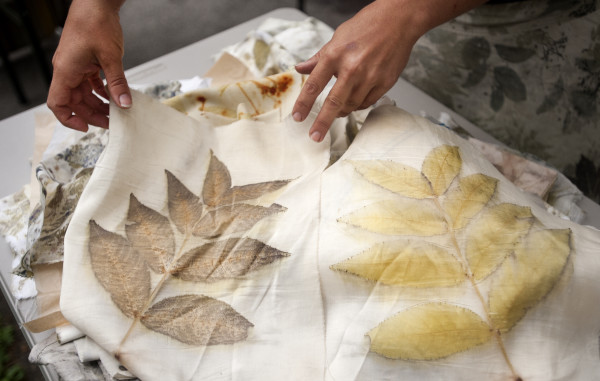 With Amelia Poole's eco-printed textiles, she uses a process that transfers the pigment from leaves or flowers onto textile or paper.