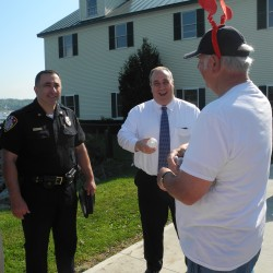 BELFAST, Maine -- Belfast Police Chief Mike McFadden, left, and Police Chief Leonard Campanello of Gloucester, Massachusetts, center, share a light moment Saturday morning with a member of the group WeCARE, or Waldo Encourages Community Assisted Recovery Efforts. The Gloucester official came to Belfast to talk about the unusual amnesty program his department has launched that has helped nearly 200 drug addicts get into rehabilitation.