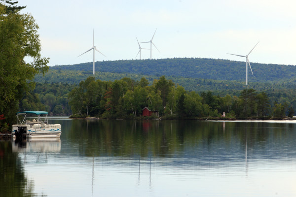 Turbines from SunEdison Inc.'s wind project in Oakfield can easily be seen from the public landing of Drew's Lake in New Limerick.