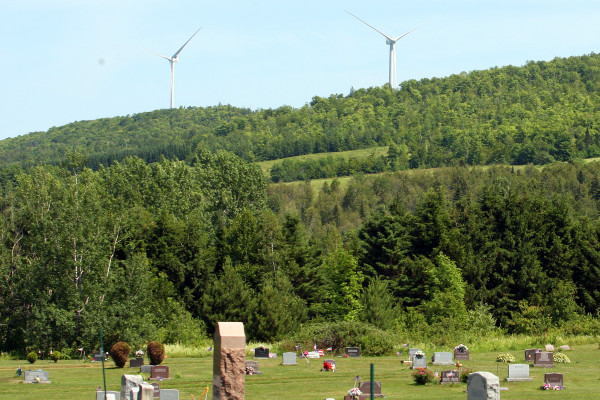 Turbines from SunEdison Inc.'s wind project in Oakfield can easily be seen from the Oakfield Cemetery.