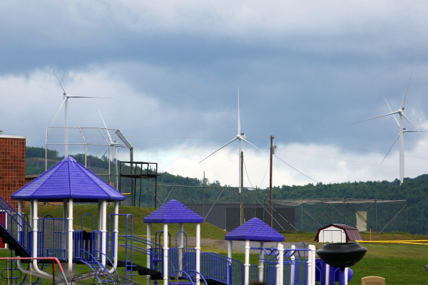 A row of wind turbines located in Oakfield is visible from the playground at Southern Aroostook Community School in neighboring Dyer Brook. The structures, which each rise 456 feet from the base to the highest point of an extended blade, can clearly be seen in Houlton, about 20 miles away.