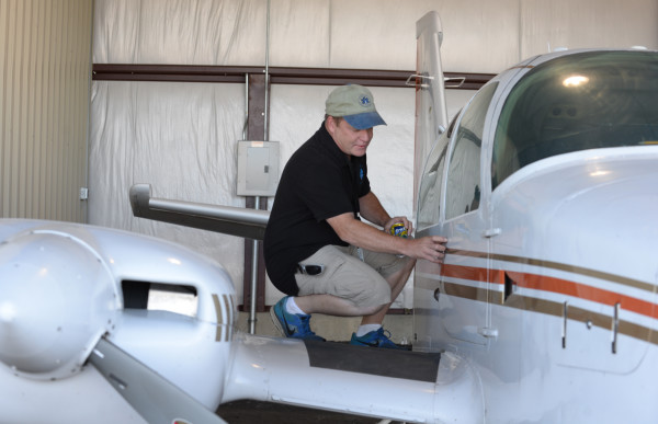 Gary Soucy, image specialist and pilot with Down East Emergency Medical Institute, gets into the cockpit of the late 1970s model Grumman Cougar twin engine plane that was donated to DEEMI by Doug Kell of Ellsworth.