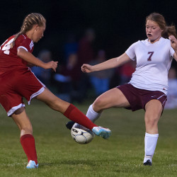 Bangor's Megan Conner (right) battles for control of the ball against Camden's Kassie Krul during their soccer game on Tuesday in Bangor.