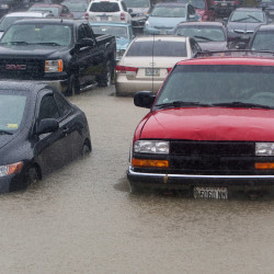 Cars sit in high water Wednesday  in the Eastern Maine Medical Center parking lot in Bangor. Sudden rainfall caused many spots in the Bangor area to flood.