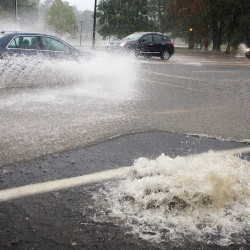 Stormwater lifts a manhole cover in Portland's Parkside neighborhood on Wednesday.