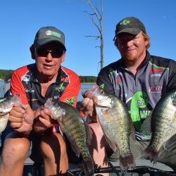 Charlie Bunting, left, and his son Travis know that big crappies can be caught at Truman Lake, even in the heat of summer.