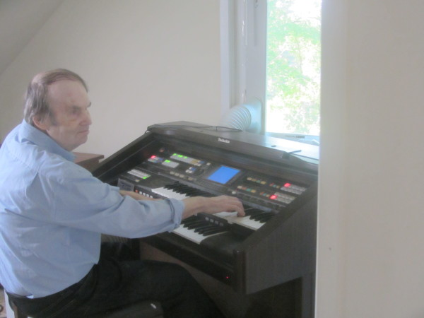 William Dean performs on the organ, an instrument he mastered without any training
