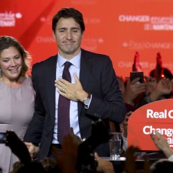 Liberal Party leader Justin Trudeau stands with his wife Sophie Gregoire as he gives his victory speech after Canada's federal election in Montreal, Quebec, October 19, 2015.
