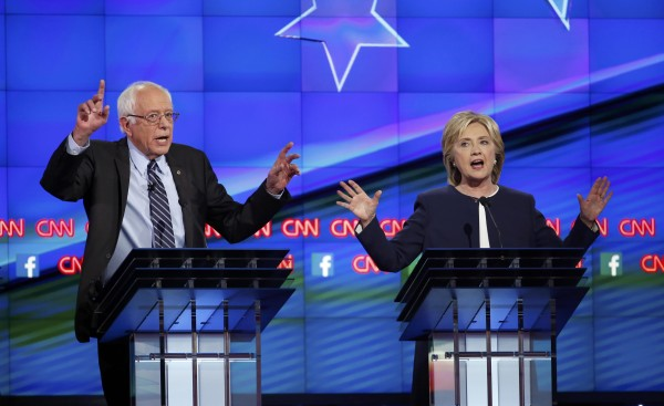 Democratic presidential candidates U.S. Sen. Bernie Sanders (left) and former Secretary of State Hillary Clinton debate during the first official Democratic candidates debate of the 2016 presidential campaign in Las Vegas, Nevada, Oct. 13, 2015.