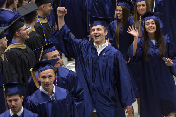 Graduates make their way to their seats during the 150th anniversary year commencement ceremony at the University of Maine in Orono, May 9, 2015.