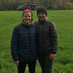 Amy McConaughy (left) and Kelly Wood after their rescue by a Maine Army National Guard Blackhawk helicopter.