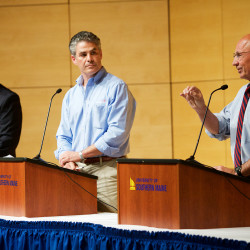 Three candidates for Portland's mayor's seat (from left) Tom MacMillan, Ethan Strimling and Michael Brennan, spar in Hannaford Hall at the University of Southern Maine on Oct. 7.