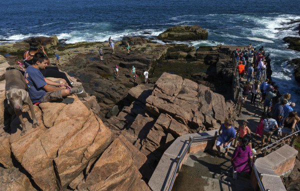 Acadia National Park visitors congregate at Thunder Hole, July 3, 2015. Park officials, hoping to clarify and simplify the process, this week announced new special use permit requirements for groups that gather in Acadia.